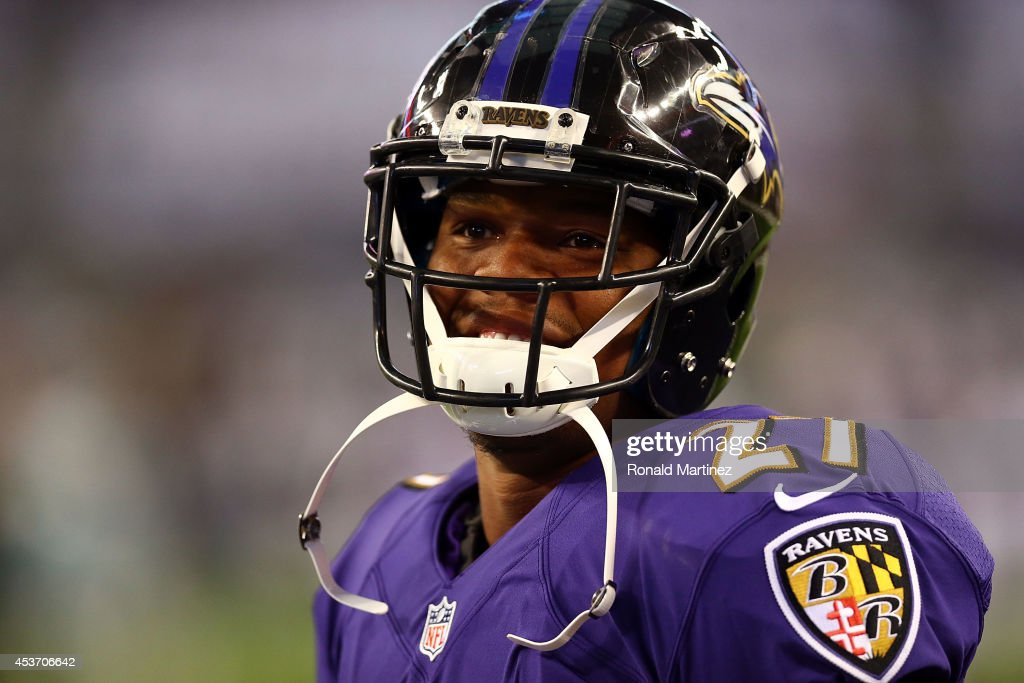 Ray Rice of the Baltimore Ravens smiles during warm ups before their game against the Dallas Cowboys at ATT Stadium on August 16 2014 in Arlington...
