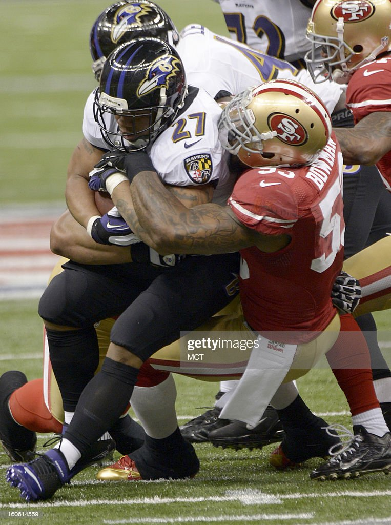 Ray Rice (27) of the Baltimore Ravens ties up Ahmad Brooks (55) of the San Francisco 49ers during first-half action in Super Bowl XLVII at the Mercedes-Benz Superdome in New Orleans, Louisiana, Sunday, February 3, 2013.