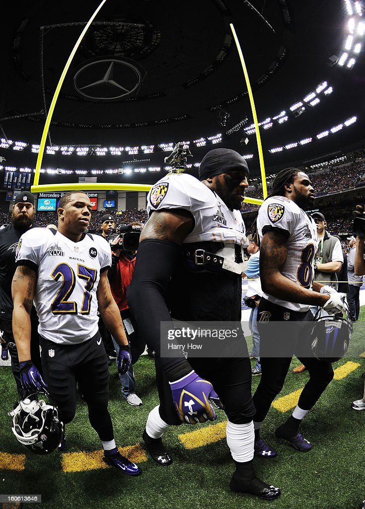 Ray Rice #27, Ray Lewis #52 and Torrey Smith #82 of the Baltimore Ravens walk onto the field against the San Francisco 49ers during Super Bowl XLVII at the Mercedes-Benz Superdome on February 3, 2013 in New Orleans, Louisiana.
