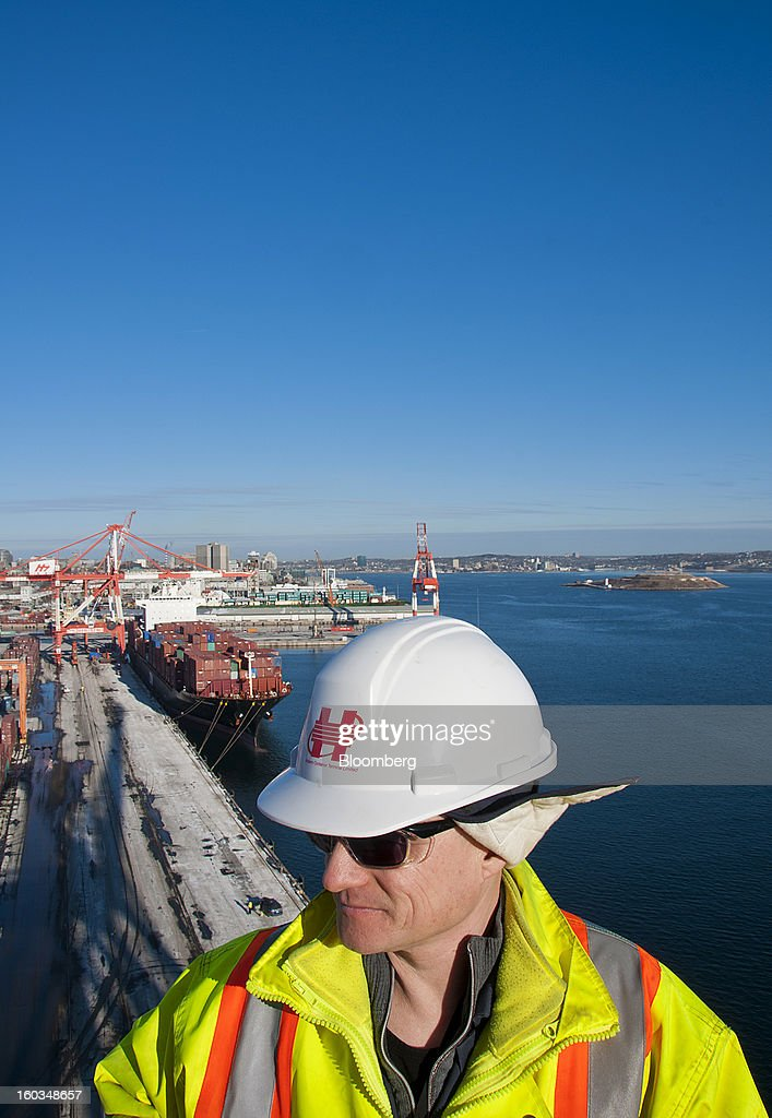 Ray Richard, maintenance planner at Halterm Ltd., stands on top of a crane overlooking the Port Of Halifax's South End container terminal, operated by Halterm Ltd., in Halifax, Nova Scotia, Canada, on Tuesday, Jan. 29, 2013. Statistics Canada (STCA) is scheduled to release gross domestic product data on Jan. 31. Photographer: Aaron McKenzie Fraser/Bloomberg via Getty Images