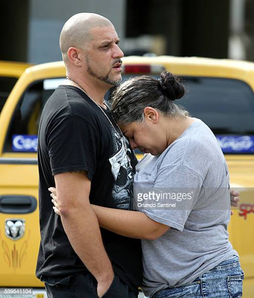 Ray Rivera DJ at the Pulse nightclub is consoled by a friend outside of the Orlando Police Department on Sunday June 12 2016