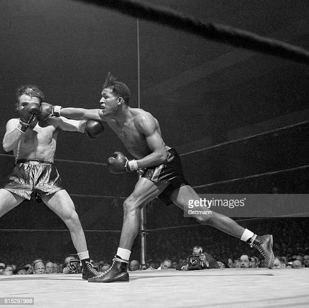 Ray Robinson Harlem's 'uncrowned welter champ' connects with a long right to Jake LaMotta's head at Madison Square Garden