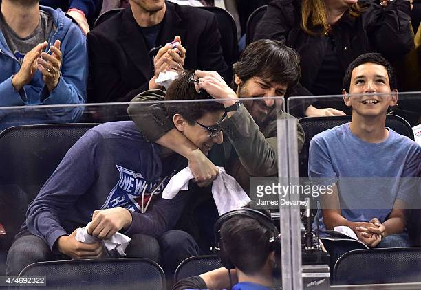 Ray Romano and guest attend the Tampa Bay Lightning vs New York Rangers playoff game at Madison Square Garden on May 24 2015 in New York City