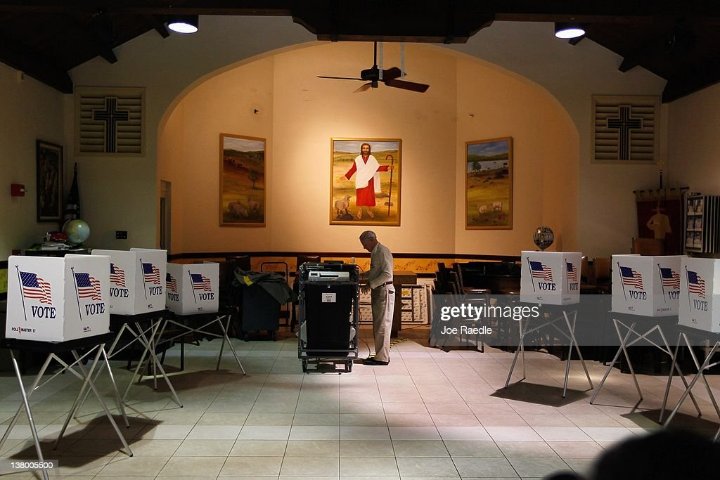 Ray Roy sets up a polling station as they prepare for voters on primary day on January 31, 2012 in Tampa, Florida. The Republican voters head to the polls as their party continues the process of deciding who will be their general election candidate against President Barack Obama.