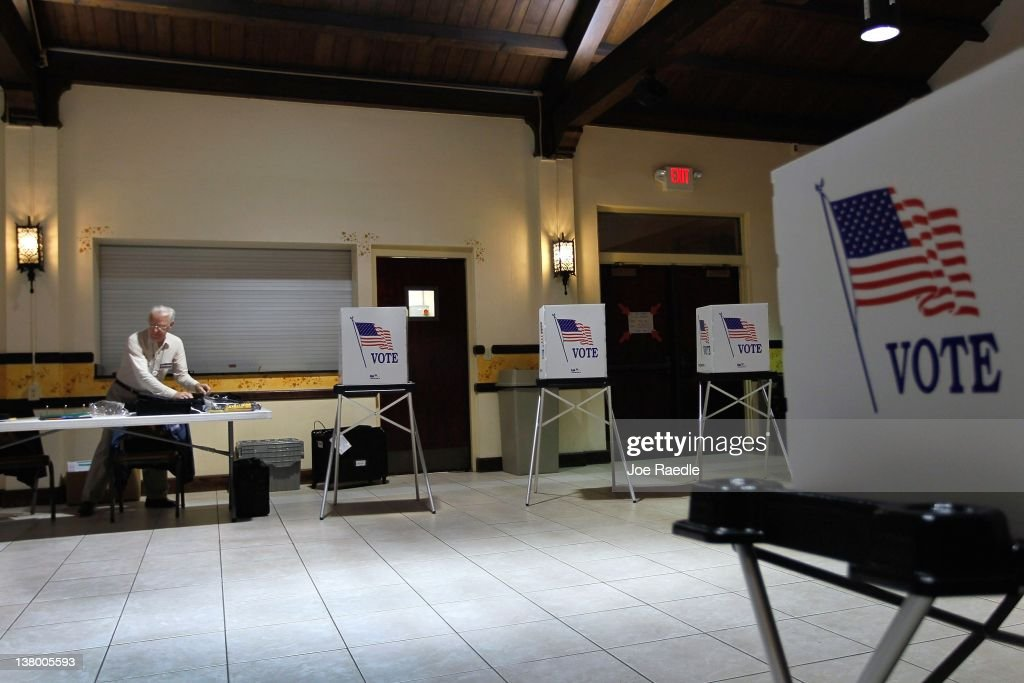 Ray Roy sets up a polling station as they prepare for voters on primary day on January 31, 2012 in Tampa, Florida. Republican voters head to the polls as their party continues the process of deciding who will be their general election candidate against President Barack Obama.