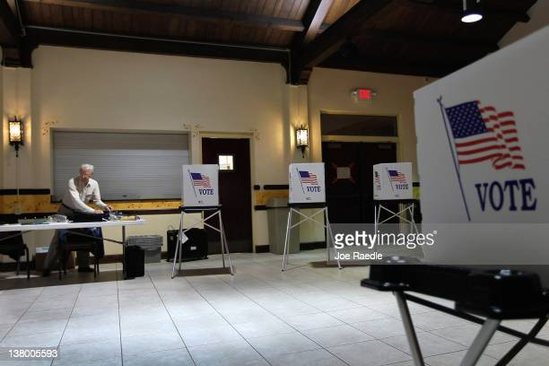 Ray Roy sets up a polling station as they prepare for voters on primary day on January 31 2012 in Tampa Florida Republican voters head to the polls...
