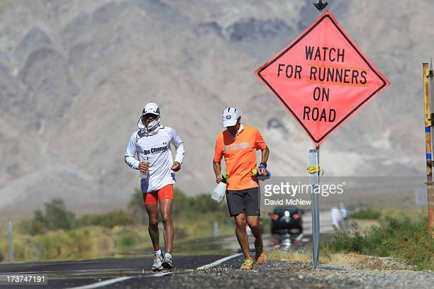 Ray Sanchez of Sacramento California runs along highway 136 north of Lake Owens as he approaches the town of Lone Pine during the AdventurCORPS...
