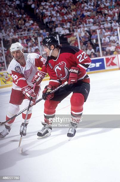 Ray Sheppard of the Detroit Red Wings and Claude Lemieux of the New Jersey Devils go for the puck during Game 2 of the 1995 Stanley Cup Finals on...