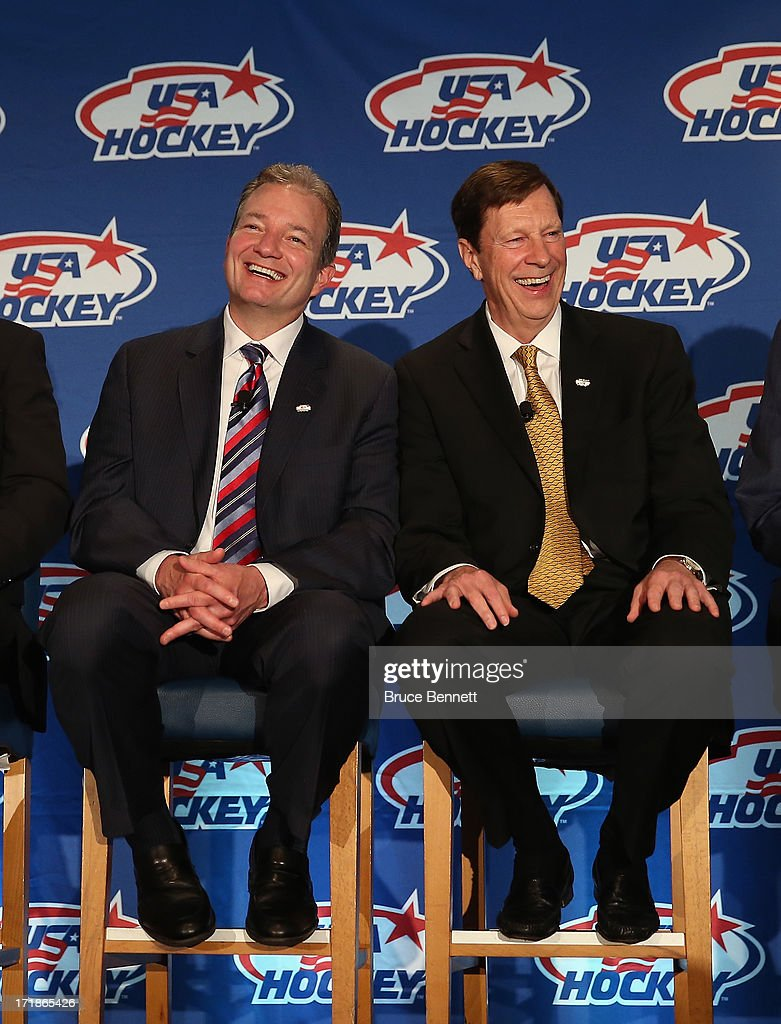 Ray Shero, the associate general manager and David Poile, the general manager of the 2014 Men's Olympic Hockey Team speak with the media at the Marriott Marquis Hotel on June 29, 2013 in New York City.