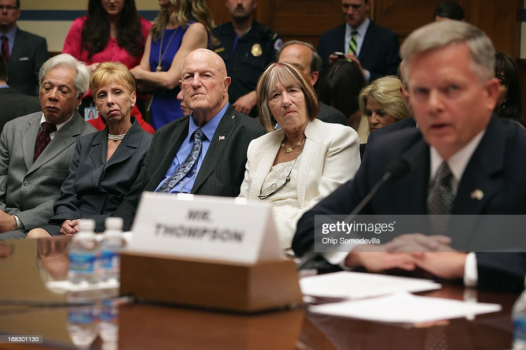 Ray Smith (C) and Pat Smith (2nd R), parents of Sean Smith, one of the four Americans killed in the September 11, 2012 terror attack on the U.S. Consulate in Benghazi, Libya, listen to Acting Deputy Assistant Secretary of State for Counterterrorism Mark Thompson (R) testify before the House Oversight and Government Reform Committee during a hearing titled, 'Benghazi: Exposing Failure and Recognizing Courage' in the Rayburn House Office Building on Capitol Hill May 8, 2013 in Washington, DC. Committee Chairman Darrell Issa (R-CA) is leading the GOP investigation of the Sept. 11, 2012, assaults that killed U.S. Ambassador J. Christopher Stevens and three other Americans, which is now focused on the State Department and whether officials there deliberately misled the public about the nature of the assault.