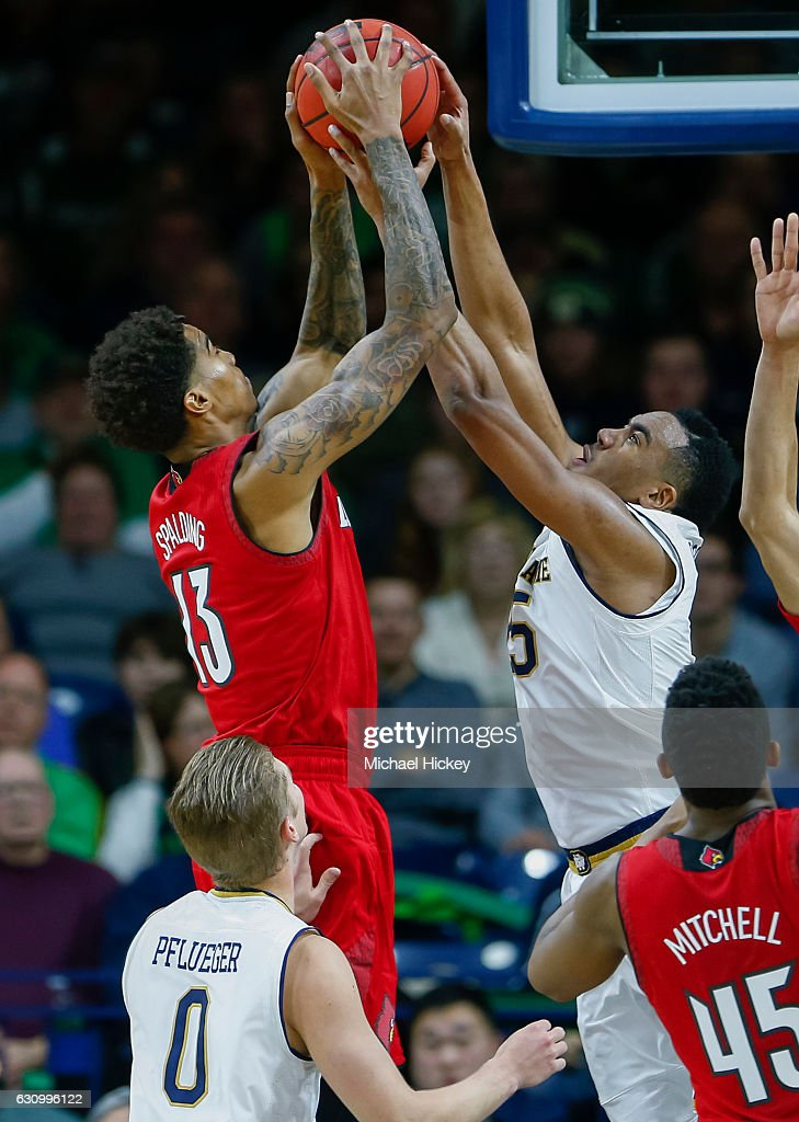 Ray Spalding #13 of the Louisville Cardinals and Bonzie Colson #35 of the Notre Dame Fighting Irish battle for the rebound at Purcell Pavilion on January 4, 2017 in South Bend, Indiana.