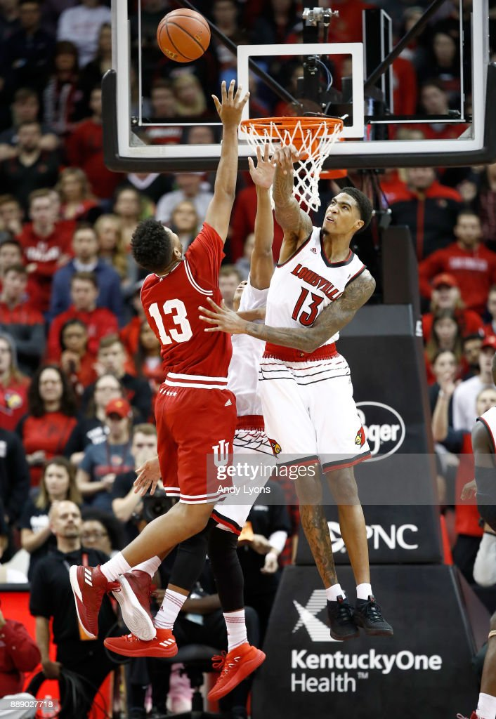 Ray Spalding #13 of the Louisville Cardinals blocks the shot of Juwan Morgan #13 of the Indiana Hoosiers during the game at KFC YUM! Center on December 9, 2017 in Louisville, Kentucky.