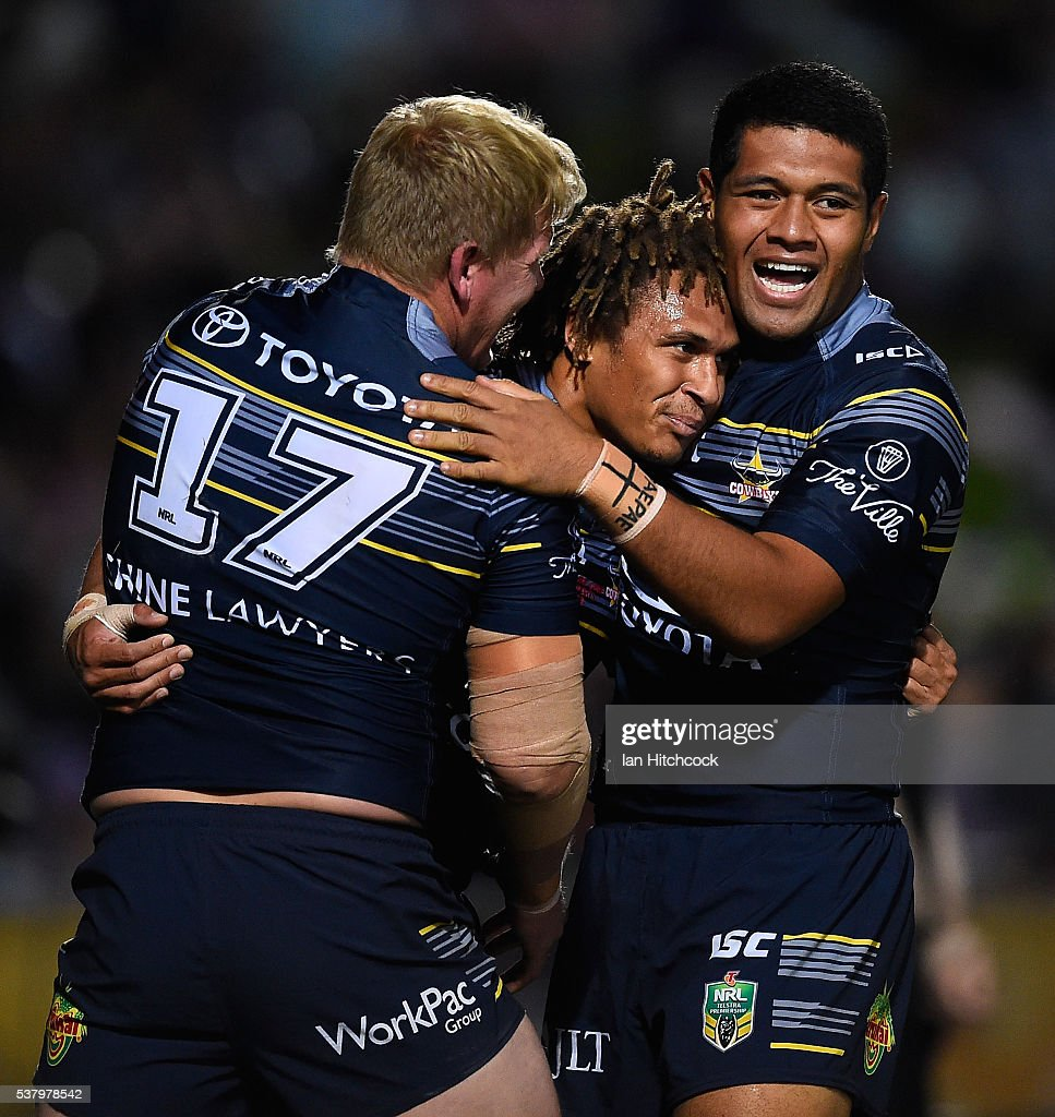 Ray Thompson (c) of the Cowboys celebrates after scoring a try with Ben Hannant and John Asiata of the Cowboys during the round 13 NRL match between the North Queensland Cowboys and the Newcastle Knights at 1300SMILES Stadium on June 4, 2016 in Townsville, Australia.