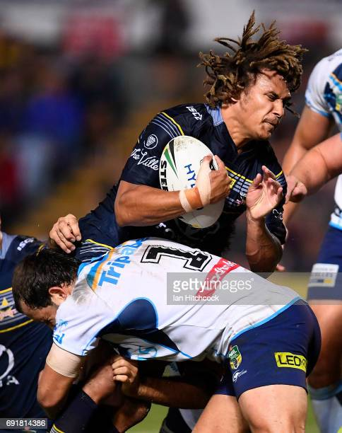 Ray Thompson of the Cowboys is tackled by Tyrone Roberts of the Titans during the round 13 NRL match between the North Queensland Cowboys and the...