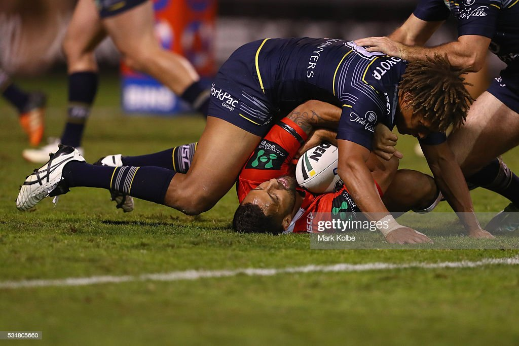 Ray Thompson of the Cowboys tackles <a gi-track='captionPersonalityLinkClicked' href=/galleries/search?phrase=Benji+Marshall&family=editorial&specificpeople=215506 ng-click='$event.stopPropagation()'>Benji Marshall</a> of the Dragons during the round 12 NRL match between the St George Illawarra Dragons and the North Queensland Cowboys at WIN Jubilee Stadium on May 28, 2016 in Wollongong, Australia.