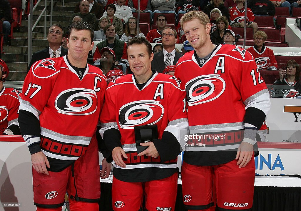 Ray Whitney of the Carolina Hurricanes is congratulated by teammates Rod Brind'Amour and Eric Staal during a pregame ceremony at a game against the...
