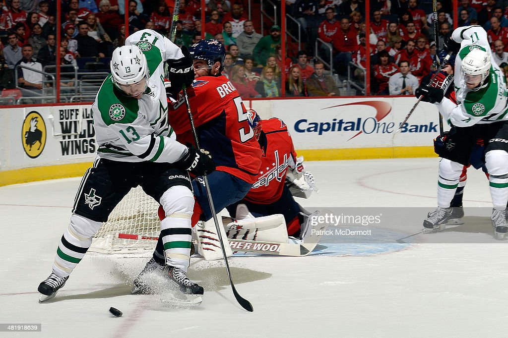 <a gi-track='captionPersonalityLinkClicked' href=/galleries/search?phrase=Ray+Whitney&family=editorial&specificpeople=202090 ng-click='$event.stopPropagation()'>Ray Whitney</a> #13 of the Dallas Stars battles for the puck against Julien Brouillette #59 of the Washington Capitals in the first period during an NHL game at Verizon Center on April 1, 2014 in Washington, DC.
