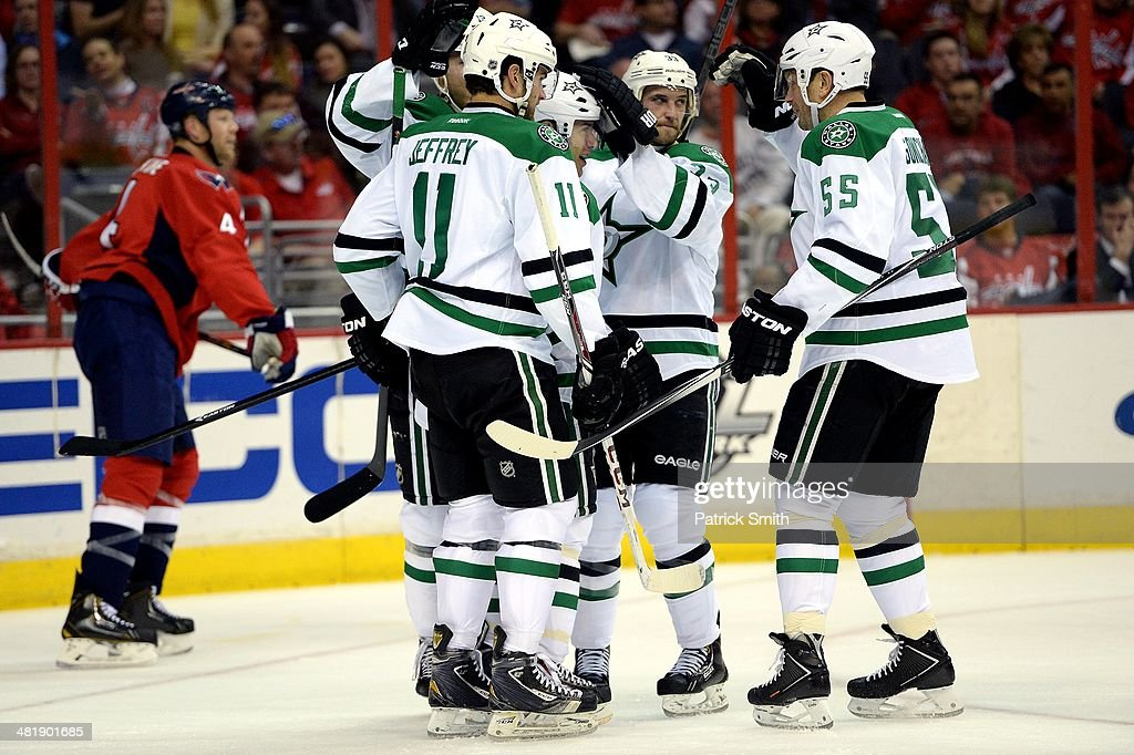 Ray Whitney #13 of the Dallas Stars celebrates with teammates after scoring a goal against the Washington Capitals in the second period during an NHL game at Verizon Center on April 1, 2014 in Washington, DC.