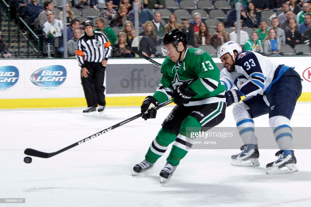 <a gi-track='captionPersonalityLinkClicked' href=/galleries/search?phrase=Ray+Whitney&family=editorial&specificpeople=202090 ng-click='$event.stopPropagation()'>Ray Whitney</a> #13 of the Dallas Stars fires a shot on goal off the breakaway against <a gi-track='captionPersonalityLinkClicked' href=/galleries/search?phrase=Dustin+Byfuglien&family=editorial&specificpeople=672505 ng-click='$event.stopPropagation()'>Dustin Byfuglien</a> #33 of the Winnipeg Jets at the American Airlines Center on October 26, 2013 in Dallas, Texas.