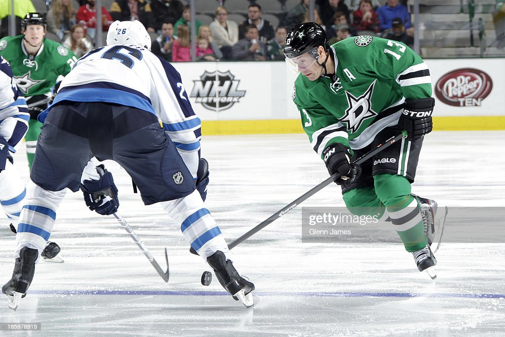 <a gi-track='captionPersonalityLinkClicked' href=/galleries/search?phrase=Ray+Whitney&family=editorial&specificpeople=202090 ng-click='$event.stopPropagation()'>Ray Whitney</a> #13 of the Dallas Stars handles the puck against <a gi-track='captionPersonalityLinkClicked' href=/galleries/search?phrase=Blake+Wheeler&family=editorial&specificpeople=716703 ng-click='$event.stopPropagation()'>Blake Wheeler</a> #26 of the Winnipeg Jets at the American Airlines Center on October 26, 2013 in Dallas, Texas.