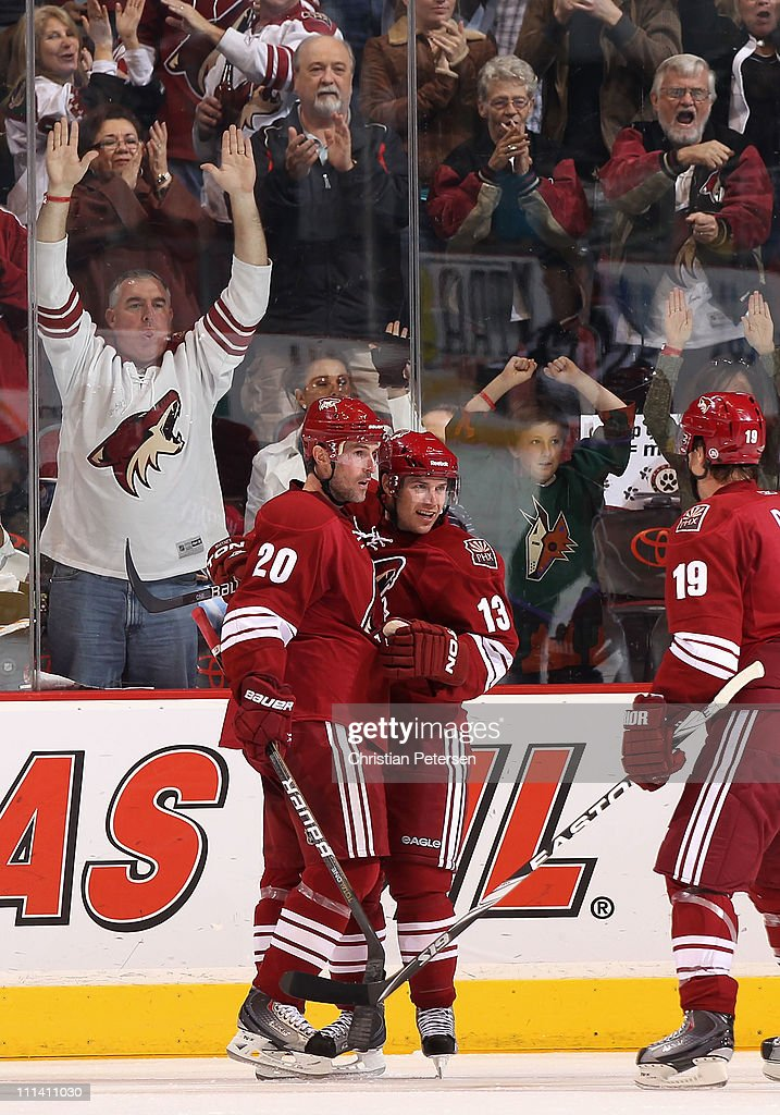 Ray Whitney of the Phoenix Coyotes celebrates with teammates Eric Belanger and Shane Doan after Whitney scored a third period goal against the...