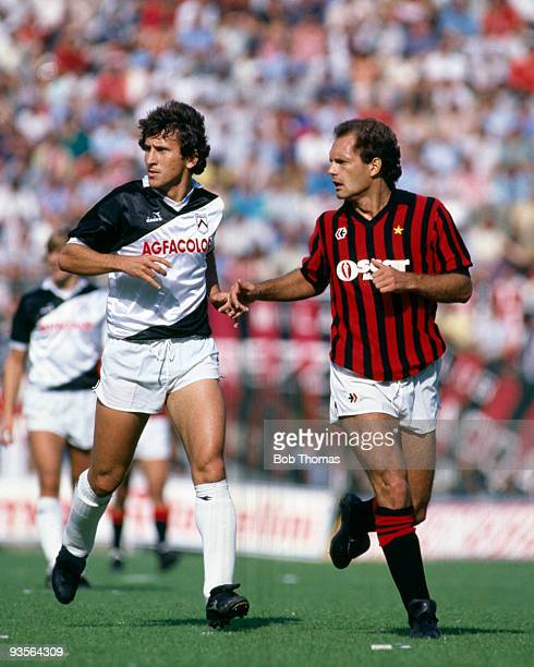 Ray Wilkins of AC Milan in action with Udinese captain Zico during the Italian League match between AC Milan and Udinese held at San Siro Milan on...