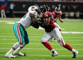 Ray Willis of the Miami Dolphins blocks against Cliff Matthews of the Atlanta Flacons during a preseason game at the Georgia Dome on August 12 2011...