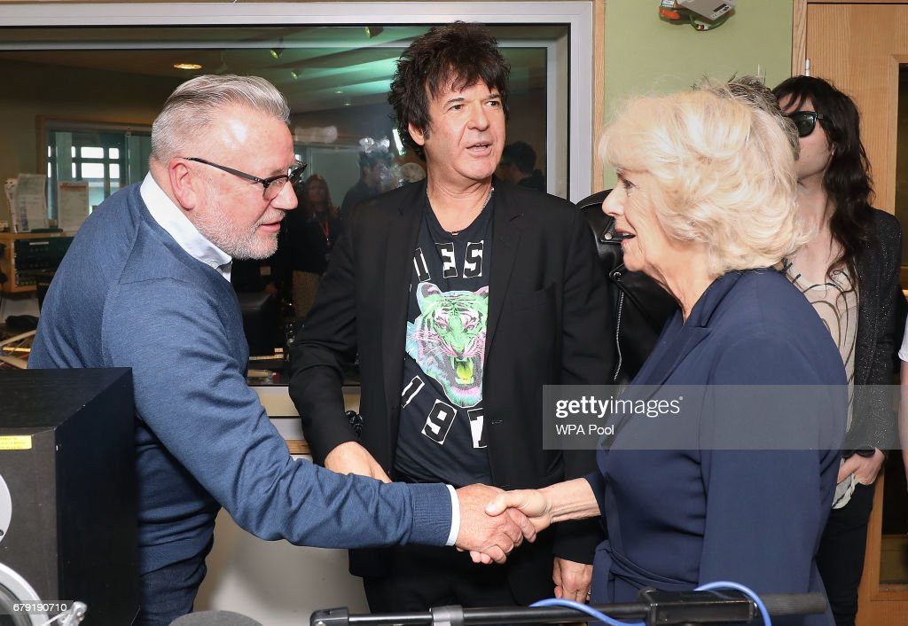 Ray Winston (L) and Blondie drummer Clem Burke (C) and in breakfast DJ Chris Evans shakes hands with Camilla, Duchess of Cornwall as she joins the '500 Word' judging panel, a creative writing competition, at BBC Radio 2 Studios on May 4, 2017 in London, England.