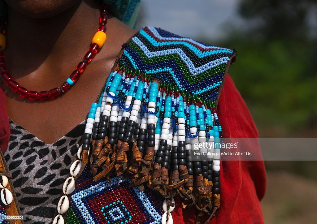 Raya tribe woman shoulder with a beaded baby carrier semien wollo zone woldia Ethiopia on February 24 2016 in Woldia Ethiopia