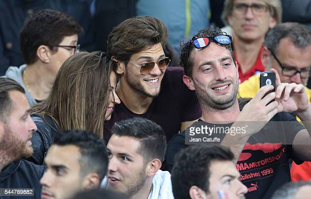 Rayane Bensetti and Denitsa Ikonomova pose for a selfie during the UEFA Euro 2016 quarter final match between France and Iceland at Stade de France...
