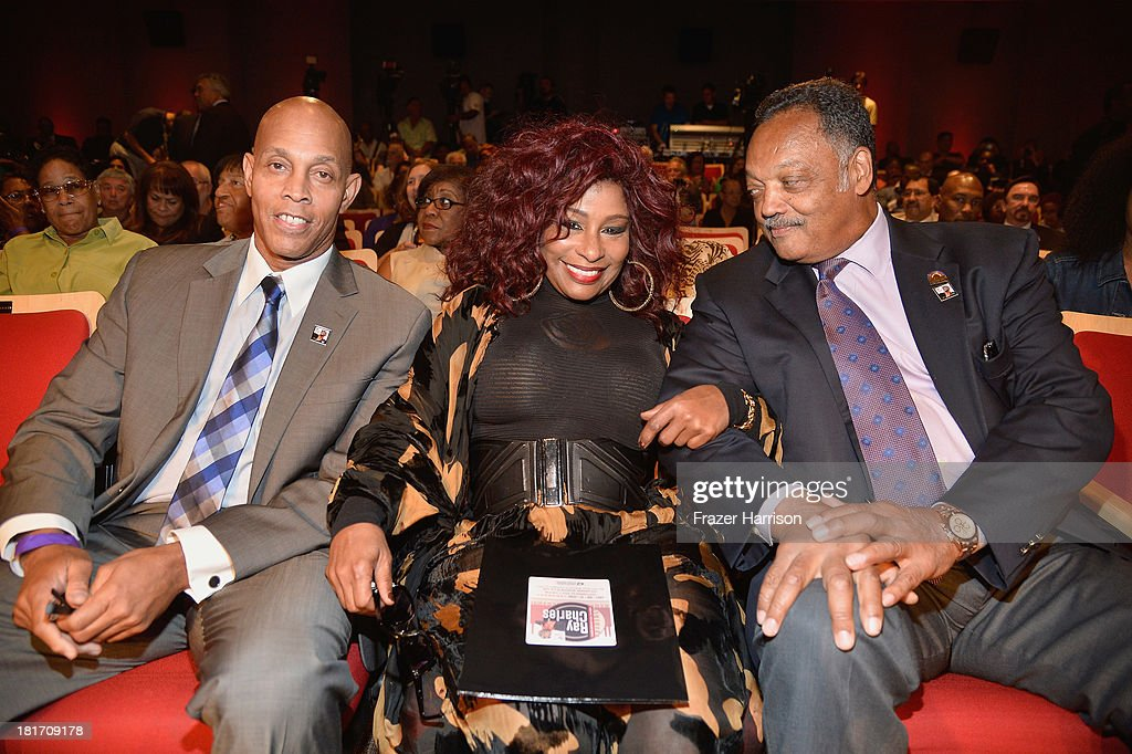 Raye Charles RobinsonJr singer Chaka Khan and Reverend Jesse Jackson attend the unveiling of the new Ray Charles stamp at the GRAMMY Museum in Los...