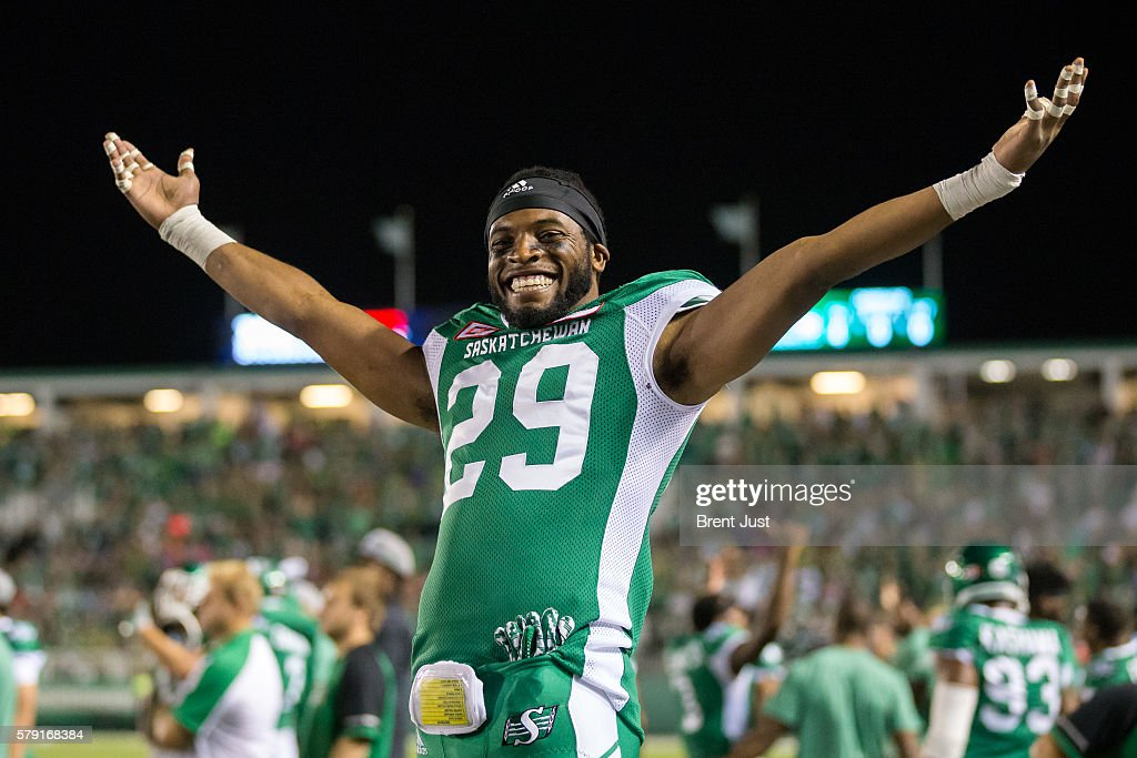 Raye Hartmann #29 of the Saskatchewan Roughriders celebrates the Roughriders first win of the season after the game between the Ottawa Redblacks and the Saskatchewan Roughriders at Mosaic Stadium on July 22, 2016 in Regina, Canada.