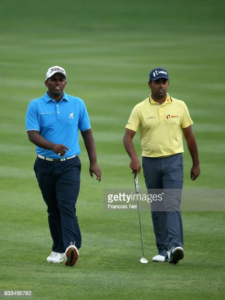Rayhan Thomas of India and Anirban Lahiri of India walk down the 9th hole during the first round of the Omega Dubai Desert Classic on the Majlis...