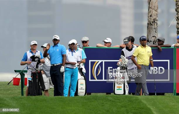 Rayhan Thomas of India on the tee at the par 4 ninth hole watched by his playing partners SSPChowrasia and Anirban Lahiri of India during the first...