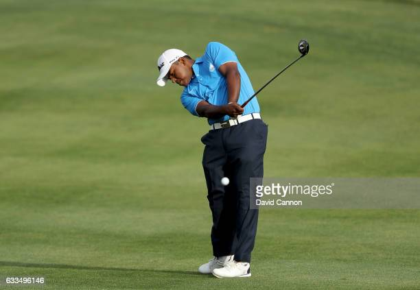 Rayhan Thomas of India plays his second shot on the par 5 10th hole during the first round of the 2017 Omega Dubai Desert Classic on the Majlis...