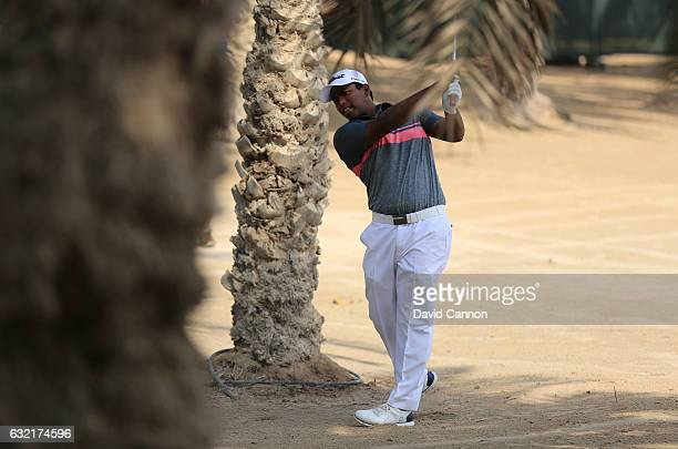 Rayhan Thomas of India plays out of trouble during the second round of the Abu Dhabi HSBC Championship at the Abu Dhabi Golf Club on January 20 2017...