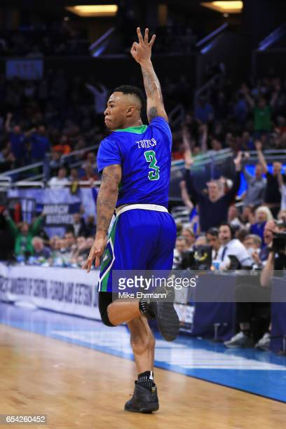 Rayjon Tucker of the Florida Gulf Coast Eagles celebrates after making a three point basket in the first half against the Florida State Seminoles...
