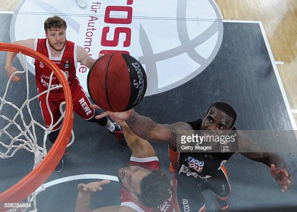 Raymar Morgan goes to the hoop against Elias Harris while Lucca Staiger watchs the scene during the BEKO BBL Final game 1 between Brose Baskets...