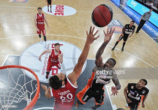 Raymar Morgan shoots agaisnt Elias Harris during the BEKO BBL Final game 1 between Brose Baskets Bamberg and ratipopharm Ulm at Brose Arena on June 5...