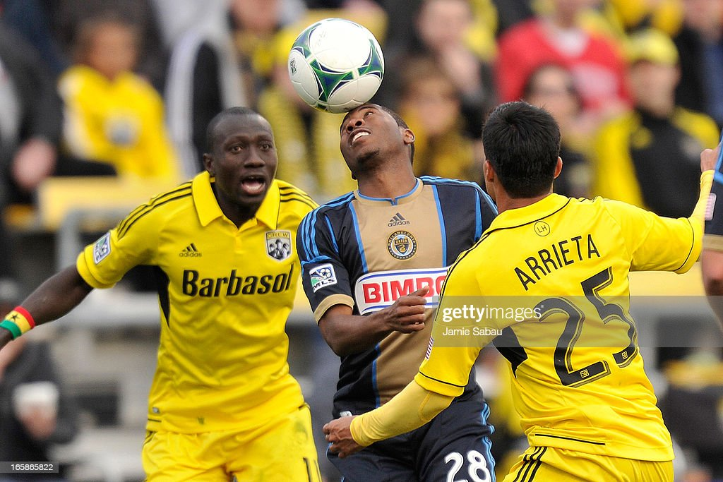 Raymon Gaddis #28 of Philadelphia Union gets control of the ball with his head between Dominic Oduro #11 of the Columbus Crew and Jairo Arrieta #25 of the Columbus Crew in the second half on April 6, 2013 at Crew Stadium in Columbus, Ohio. Columbus and Philadelphia played to a 1-1 tie.