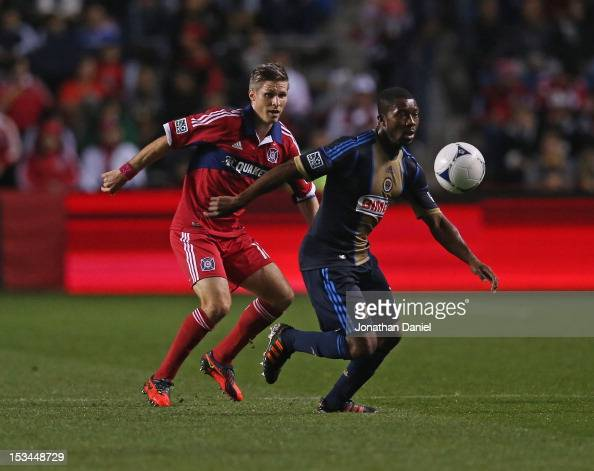 Raymon Gaddis of the Philadelphia Union moves to the ball in front of Logan Pause of the Chicago Fire during an MLS match at Toyota Park on October 3...