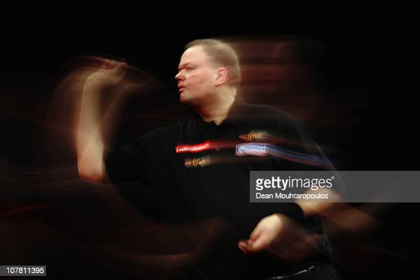 Raymond 'Barney' van Barneveld of Holland in action against Kevin McDine of England during day 11 in the 2011 Ladbrokescom World Darts Championship...