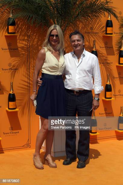 Raymond Blanc and guest arrive at the Veuve Clicquot Gold Cup Polo in Midhurst Sussex