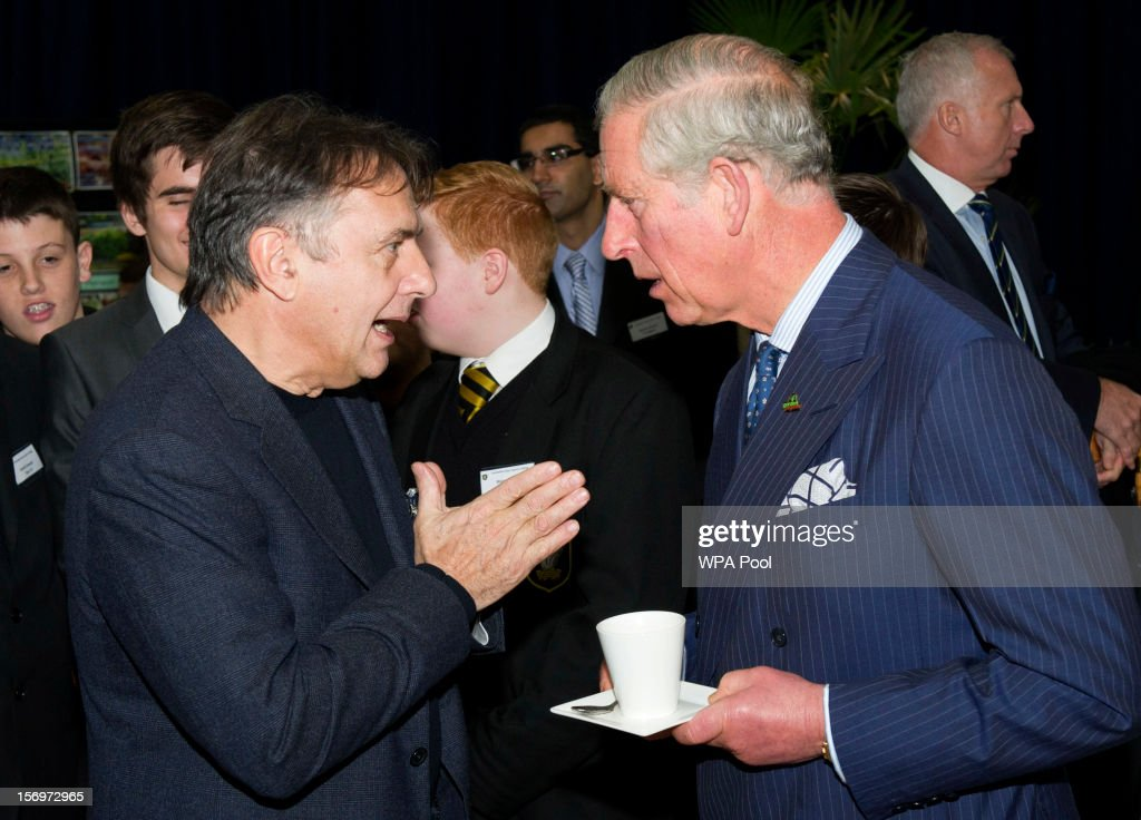 Raymond Blanc speaks with Prince Charles, Prince of Wales during a visit to Carshalton Boys Sports College with Jamie Oliver to see how the school has transformed its approach to healthy eating on November 26, 2012 in Carshalton, England.