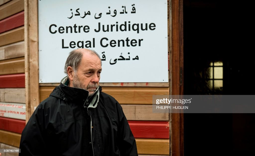 Raymond Blet, lawyer at the Legal Centre holds a press conference in the so-called 'Jungle' migrant camp in Calais, northern France, on February 12, 2016, to announce that dozens of complains will be filed for violence against migrants by police forces. / AFP / PHILIPPE HUGUEN