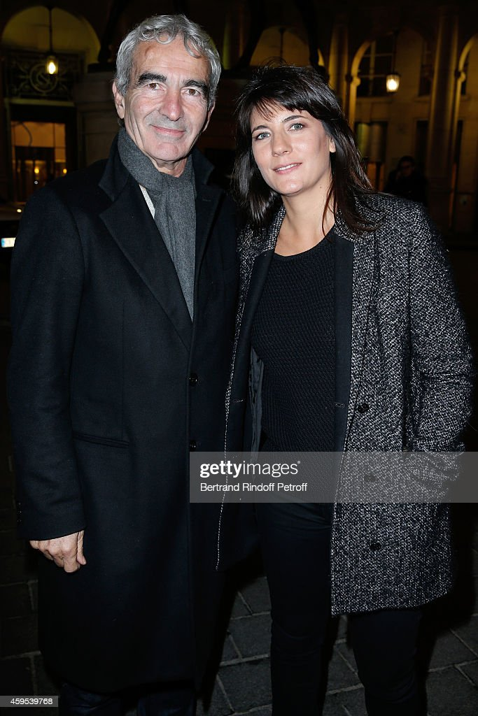 Raymond Domenech and Estelle Denis attend the 'Ma Vie Revee' : Michel Boujenah One Man Show at Theatre Edouard VII on November 24, 2014 in Paris, France.