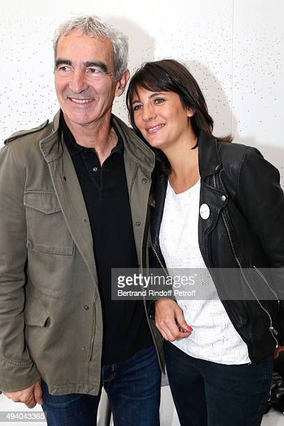 Raymond Domenech and Estelle Denis attend the Roland Garros French Tennis Open 2014 Day 3 on May 27 2014 in Paris France
