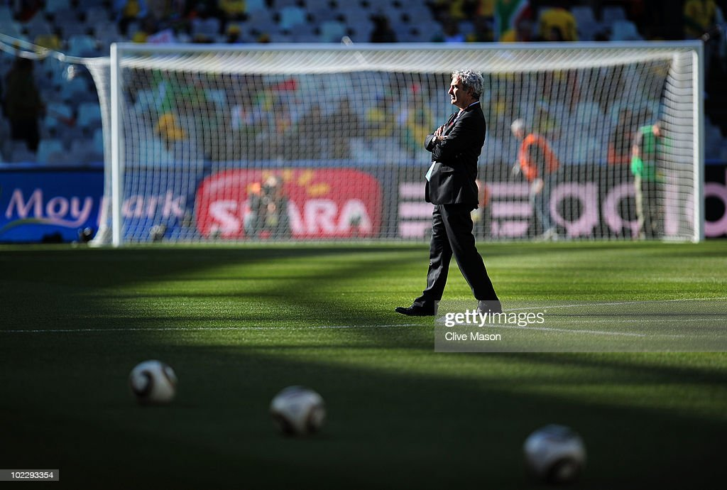 <a gi-track='captionPersonalityLinkClicked' href=/galleries/search?phrase=Raymond+Domenech&family=editorial&specificpeople=497446 ng-click='$event.stopPropagation()'>Raymond Domenech</a> head coach of France walks across the pitch prior to the 2010 FIFA World Cup South Africa Group A match between France and South Africa at the Free State Stadium on June 22, 2010 in Mangaung/Bloemfontein, South Africa.