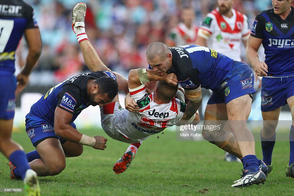 Raymond Faitala and David Klemmer of the Bulldogs tackle Jack De Belin of the Dragons during the round 14 NRL match between the St George Illawarra...