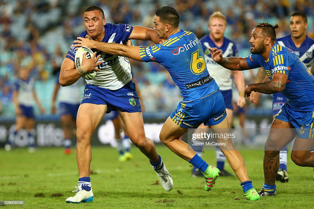 Raymond Faitala-Mariner of the Bulldogs is tackled by Corey Norman of the Eels during the round nine NRL match between the Parramatta Eels and the Canterbury Bulldogs at ANZ Stadium on April 29, 2016 in Sydney, Australia.
